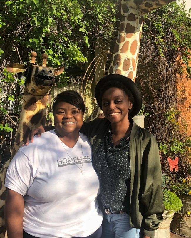 Queer Eye stars Jess Guilbeaux and Mama Tammye smiling at the camera.