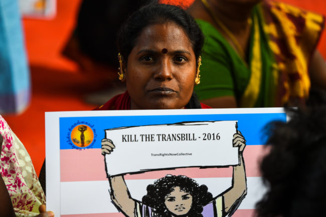 "A woman holding a placard reading ""kill the transbill"""
