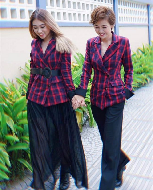 The Bachelor couple Minh Thu and Truc Nhu walk through the streets of Vietnam.