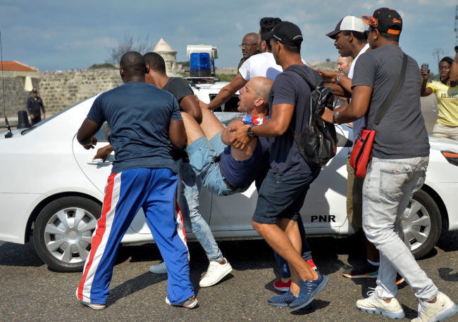 Cuban police arrest demonstrators taking part in the LGBT+ march in Havana, on May 11, 2019.
