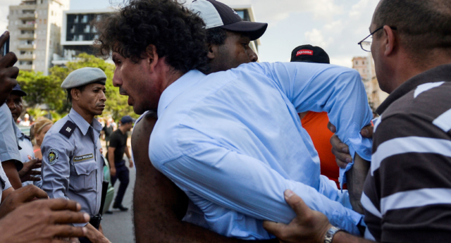 Cuban police arrest demonstrators taking part in the LGBT+ march in Havana, on May 11, 2019. (YAMIL LAGE/AFP/Getty)