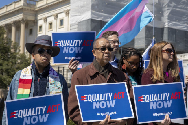 Protesters stand in support of a introduction of the Equality Act, a comprehensive LGBTQ non-discrimination bill at the US Capitol on April 01, 2019 in Washington, DC.