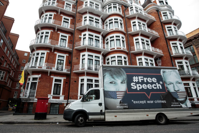 A van with a billboard in support of American whistleblower Chelsea Manning and Wikileaks founder Julian Assange is parked outside the Ecuadorian Embassy in South Kensington on April 5, 2019 in London, England.