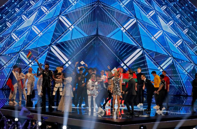 Eurovision finalists pose on the stage, where a member of Hatari waved a LGBT pride flag.