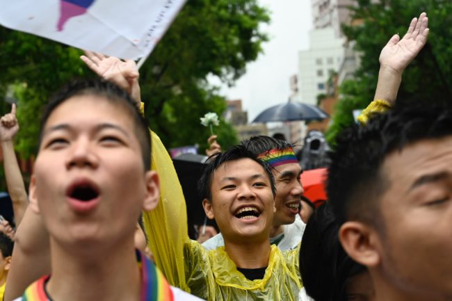 Gay rights supporters celebrate outside Parliament after lawmakers legalised same-sex marriage bill in Taipei on May 17, 2019.