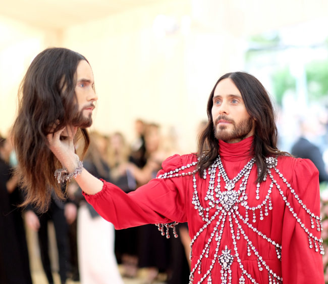 Jared Leto wears his head as an accessory.