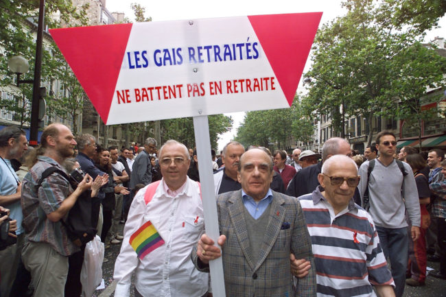 "Older LGBT people demonstrate, 24 June 2000 in Paris, during the 2000 Gay Pride, holding a sign reading ""Gay retired don't retire""."