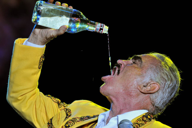 Mexican singer Vicente Fernandez drinks aguardiente during his concert on February 20, 2009 in Colombia.