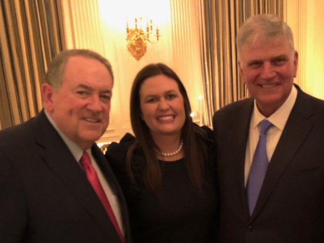 Former Arkansas Governor Mike Huckabee, White House Press Secretary Sarah Huckabee Sanders and Franklin Graham