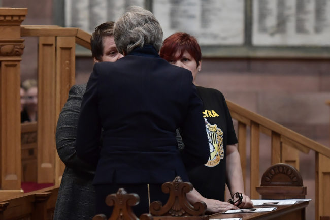 British Prime Minister Theresa May speaks with Sara Canning the funeral service of journalist Lyra McKee at St Anne's Cathedral on April 24, 2019 in Belfast, Northern Ireland.