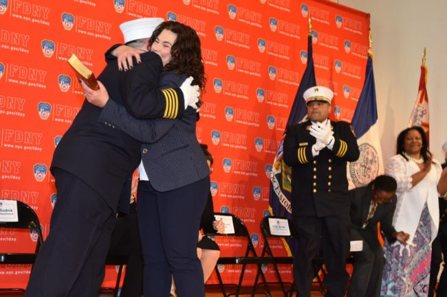Lillian Bonsignore hugs her wife Kim after being sworn in as the FDNY's EMS chief.