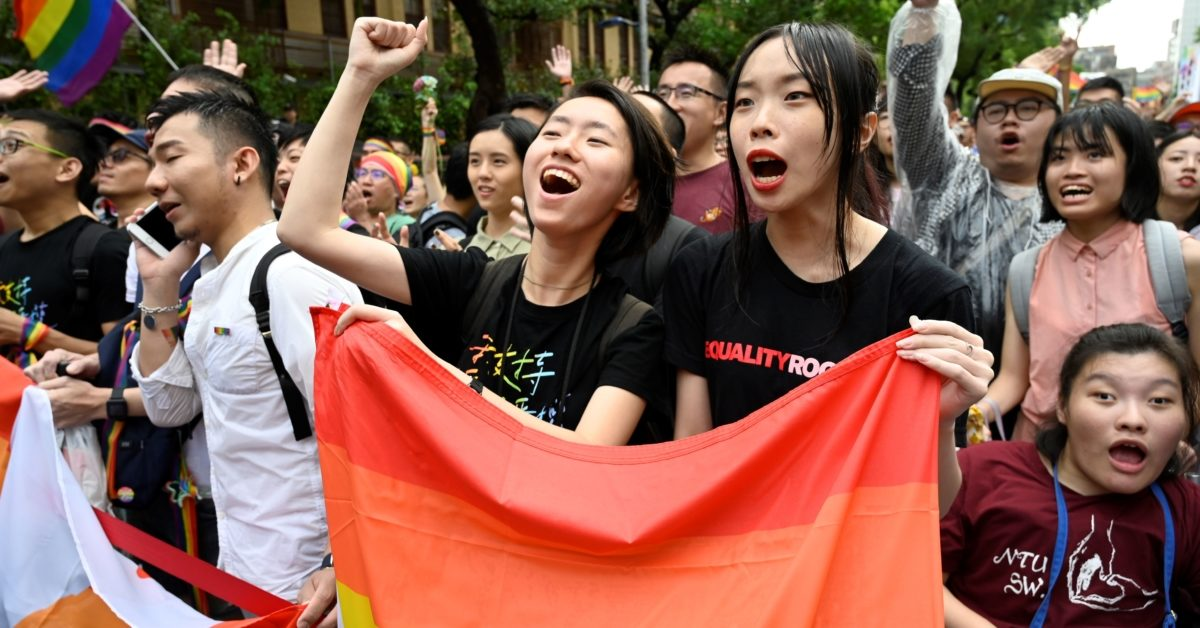 Supporters of same-sex marriage in Taiwan celebrate outside the parliament, which legalised same-sex marriage in a landmark first for Asia. (Sam Yeh/AFP/Getty)