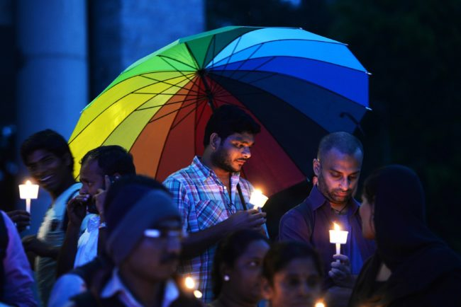American Medical Association: Transgender people take part in a candle light vigil on the Transgender Day of Remembrance in Bangalore on November 20, 2015.