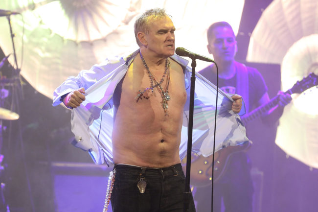 Morrissey rips off his shirt during the encore as he performs during his Broadway debut at Lunt-Fontanne Theatre on May 2, 2019 in New York City.