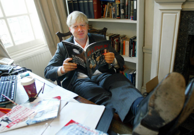 Boris Johnson sits in his London office in 2003