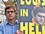 Louis Theroux with his 'gift' placard