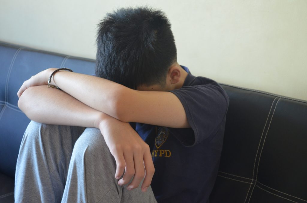 A sad boy, representing 13-year-old boy who was abused on Grindr