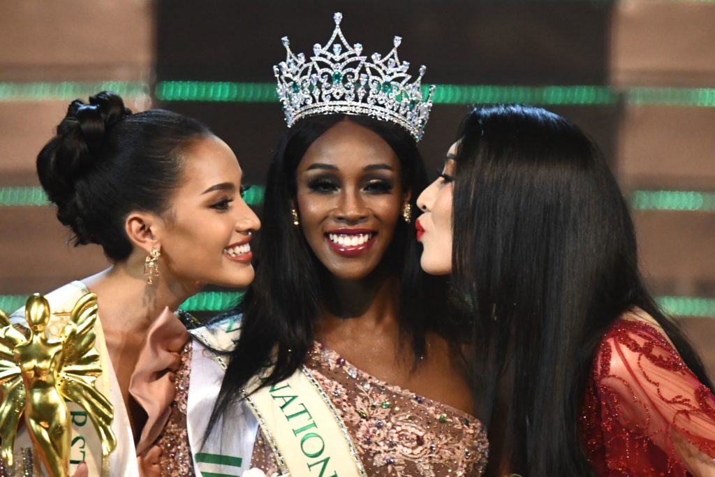 Jazell Barbie Royale (C) of the US, the Miss International Queen 2019 receives a kiss from finalists Kanwara Kaewjin (L) of Thailand and Yaya (R) of China
