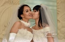 Japanese actress Akane Sugimori (R) kisses her partner Ayaka Ichinose in a 2015 protest for marriage equality, for which 13 gay couples are now suing the government on Valentine's Day.
