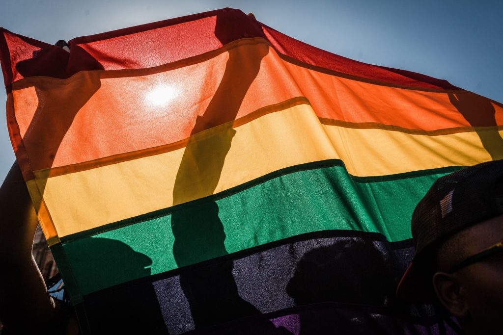 LGBt activists, like those in Botswana advocating for the decriminalisation of gay sex, with a rainbow flag take part in the annual Gay Pride Parade.