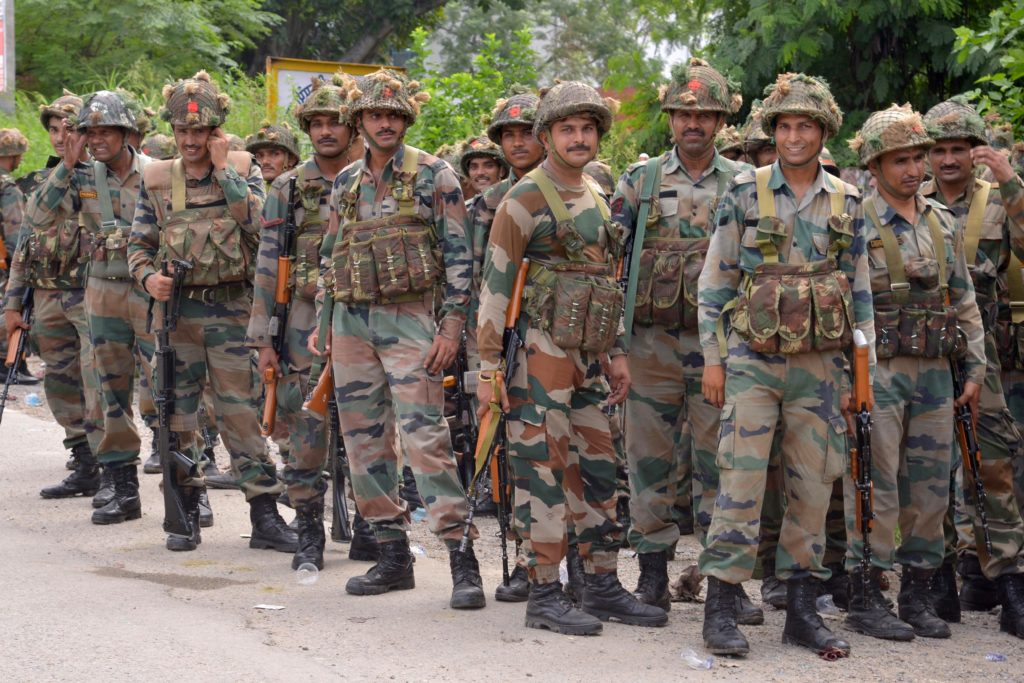 Indian Army personnel stand guard in the Gurdaspur district of Punjab state