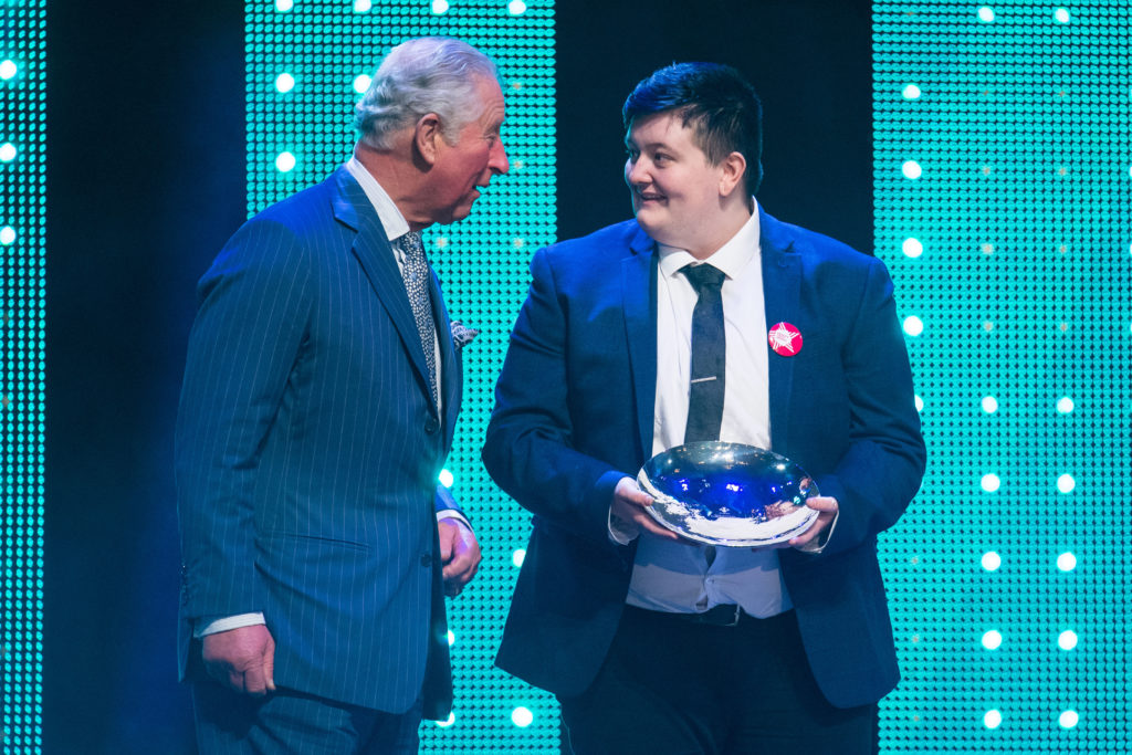 Prince Charles, Prince of Wales with winner of the Educational Award, Jay Kelly during the annual Prince's Trust Awards at the London Palladium on March 13, 2019 in London, England.