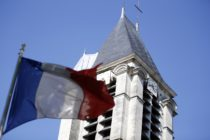 A French flag flying outside of a church