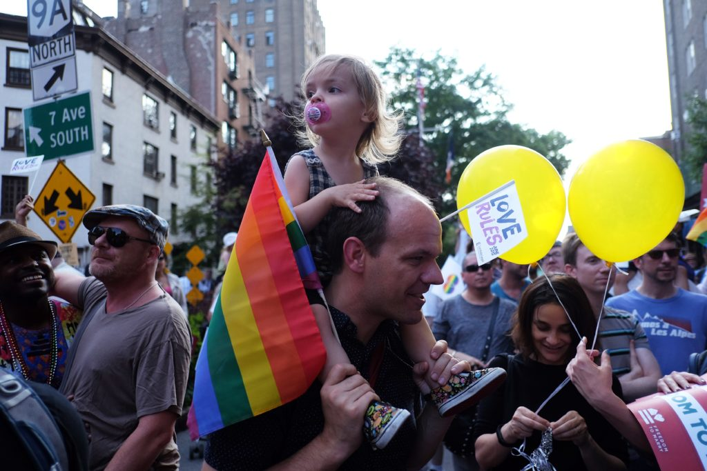A dad and child, representing two thirds of gay dads saying they face stigma in a new survey