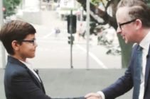 Qantas CEO Alan Joyce shakes hands with Oceania Express CEO Alex Jacquot.