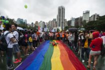People in Hong Kong take part in the LGBT parade with other lesbian, gay, bisexual and trans people in 2014