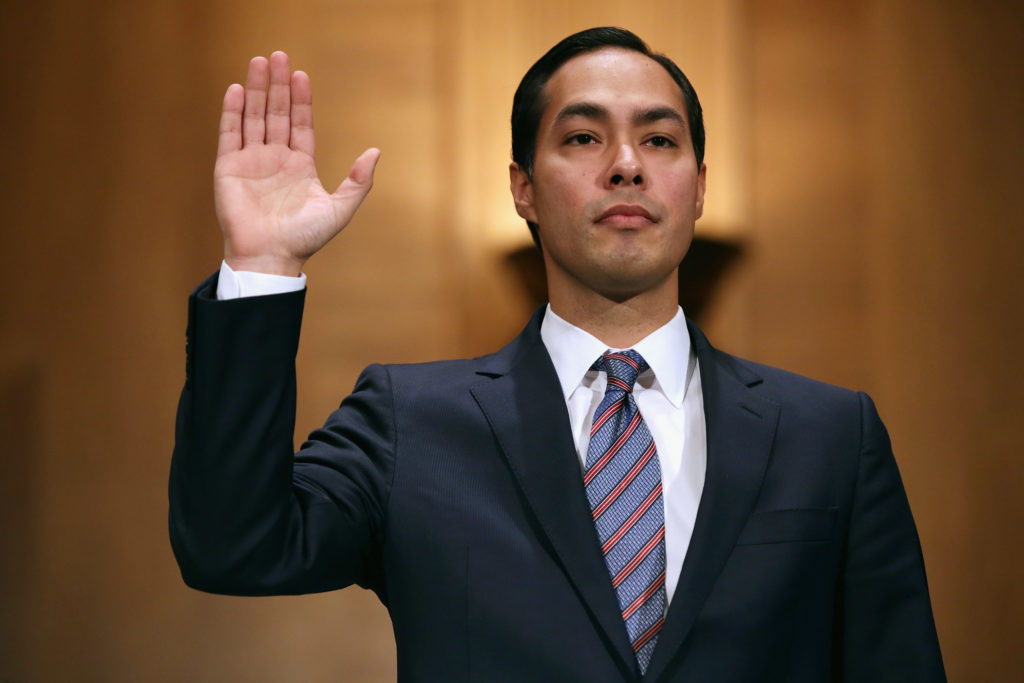 Mayor Julian Castro is sworn in during his confirmation hearing before the Senate Banking, Housing and Urban Affairs Committee in the Dirksen Senate Office Building on Capitol Hill June 17, 2014 in Washington, DC