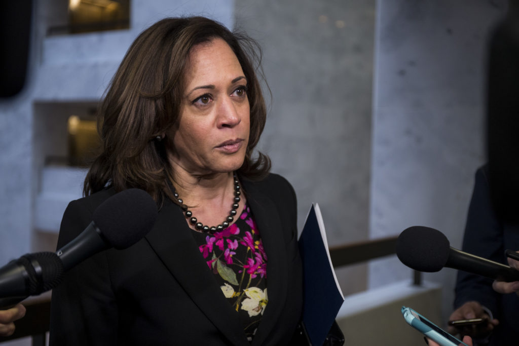 Senator Kamala Harris, who has faced criticism for her treatment of transgender prisoners, speaks to reporters following a closed briefing on intelligence matters on Capitol Hill on December 4 2018 in Washington, DC