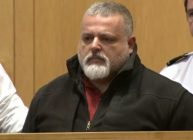 Carlos Vieira, a police officer in Lawrence, Massachusetts, sits in court