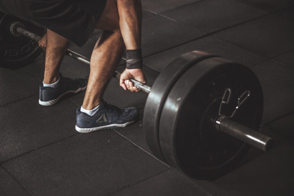 A person lifts weights.