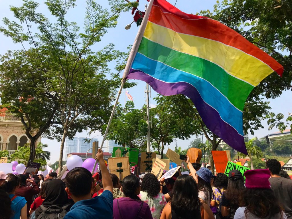 A LGBT pride flag flies at the women's march in Malaysia on March 9.