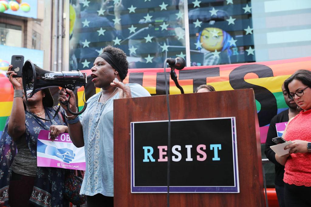 Trans army vet Tanya Walker speaks to protesters in Times Square