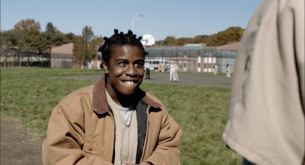 Crazy Eyes tells Piper her poem in the yard (Netflix/Orange Is the New Black)
