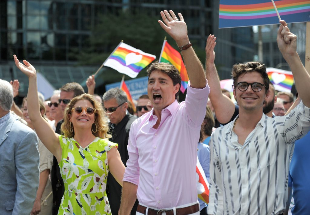 Prime Minister Justin Trudeau, who has approved the design of the new $1 coin, marches at pride.