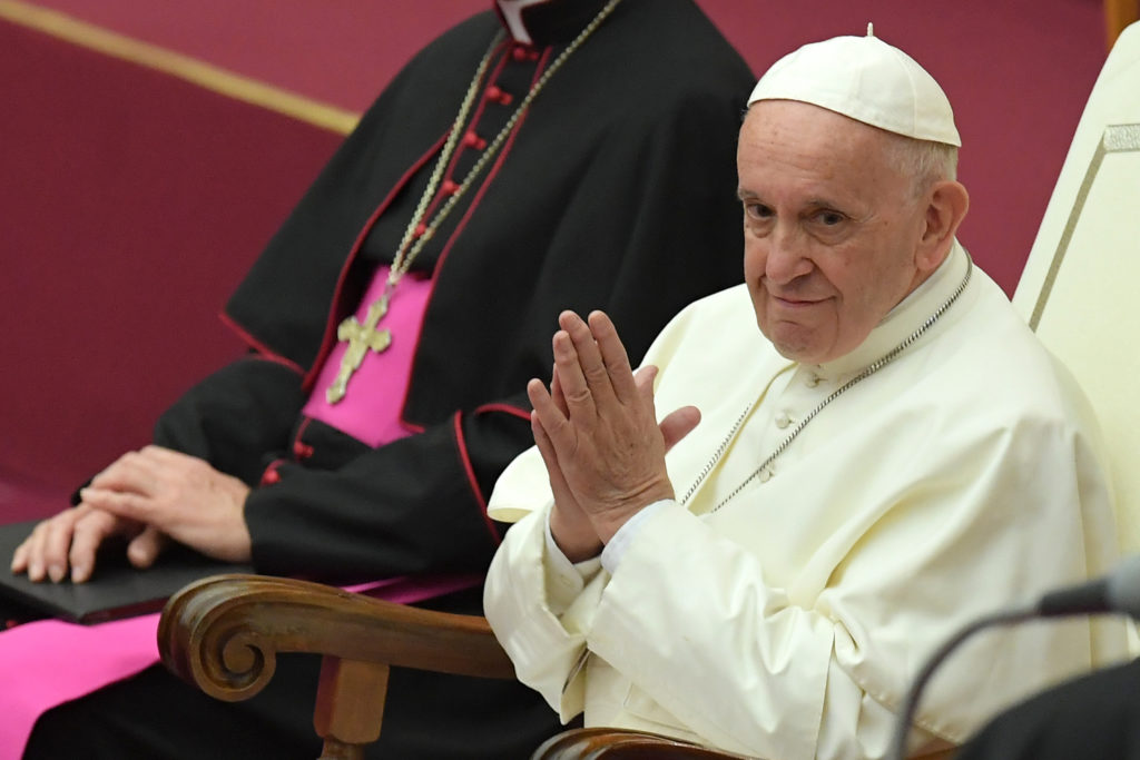 Pope Francis joins his hands during an audience for the participants to the International Meeting of Choirs on November 24, 2018.