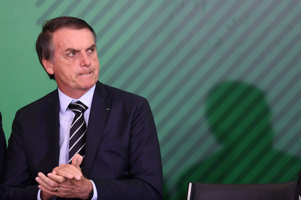 Brazilian President Jair Bolsonaro, whose elections has worried LGBT rights activists, gestures during a ceremony.