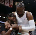 Dwyane Wade hugs his son Zion