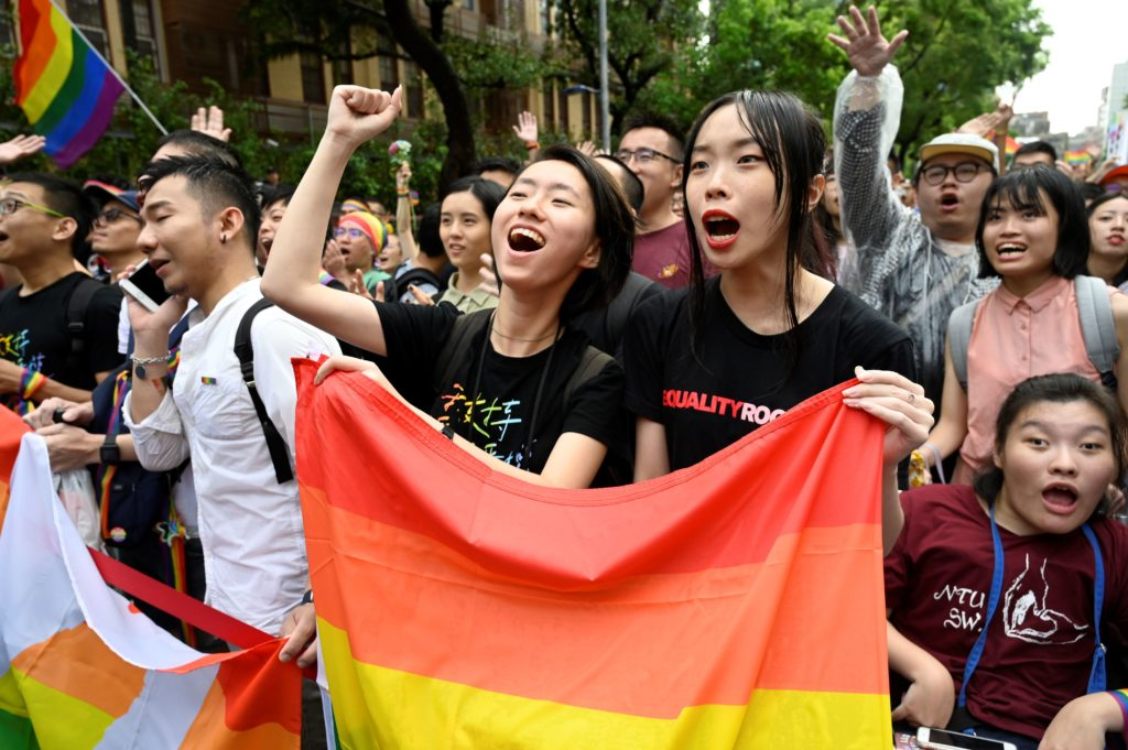 Supporters of same-sex marriage celebrate outside the parliament in Taipei on May 17, 2019. - Taiwan's parliament legalised same-sex marriage on May 17, 2019, in a landmark first for Asia as the government survived a last-minute attempt by conservatives to pass watered-down legislation.