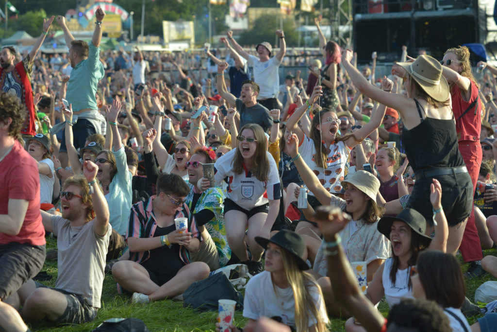 Lesbian football fan Beth Miles celebrates the Women's World Cup results at Glastonbury