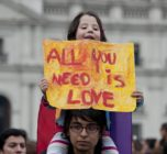 Man with daughter on shoulders protest for LGBT right