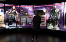 """A visitor looks at a display on Marvel Comics superhero """"Thor"""" (L) and character """"Loki"""" at the interactive Marvel Avengers STATION exhibition in the bussines district of La Defense, west of Paris, on April 13, 2016. / AFP / MIGUEL MEDINA / RESTRICTED TO EDITORIAL USE - MANDATORY MENTION OF THE ARTIST UPON PUBLICATION - TO ILLUSTRATE THE EVENT AS SPECIFIED IN THE CAPTION (Photo credit should read MIGUEL MEDINA/AFP/Getty Images)"""