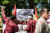 A group of Muslim protesters march with banners against the lesbian, gay, bisexual and transgender (LGBT) community in Banda Aceh on Decmber 27, 2017