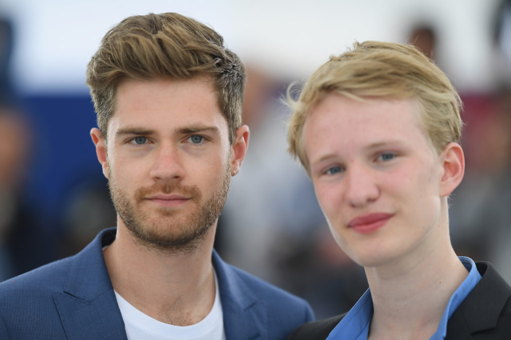 """Director Lukas Dhont (L) and actor Victor Polster attend the photocall for """"Girl"""" during the 71st annual Cannes Film Festival at Palais des Festivals on May 13, 2018 in Cannes, France."""