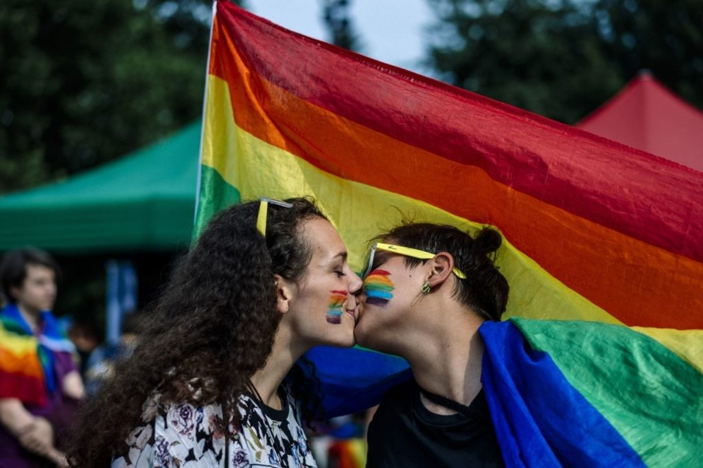 A couple kisses during the 11th Gay Pride Parade in downtown Sofia on June 9, 2018, as gays, lesbians and transsexuals march through Bulgarian capital to protest against discrimination against homosexuals and improve their integration in the society. - Thousands of people took to the streets to support LGBT rights in cities across Europe on June 9, 2018, with marchers waving rainbow flags and condemning discrimination in all its forms. (Photo by Dimitar DILKOFF / AFP) (Photo credit should read DIMITAR DILKOFF/AFP/Getty Images)