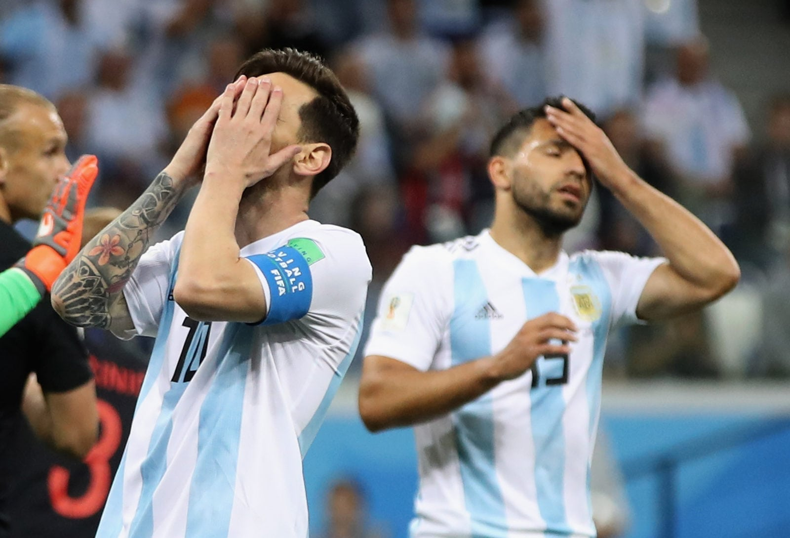 NIZHNIY NOVGOROD, RUSSIA - JUNE 21: Lionel Messi and team mate Sergio Aguero of Argentina show their dejection during the 2018 FIFA World Cup Russia group D match between Argentina and Croatia at Nizhniy Novgorod Stadium on June 21, 2018 in Nizhniy Novgorod, Russia. (Photo by Clive Brunskill/Getty Images)