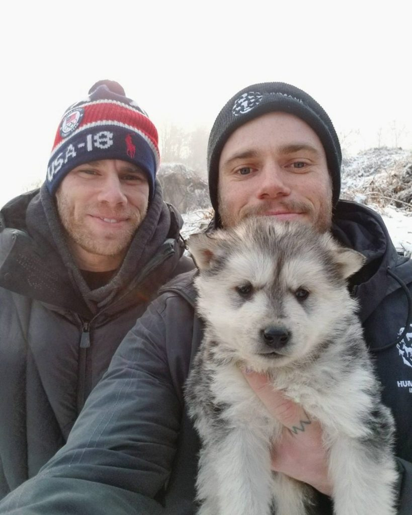Gus Kenworthy and boyfriend Matt Wilkas with puppy Beemo